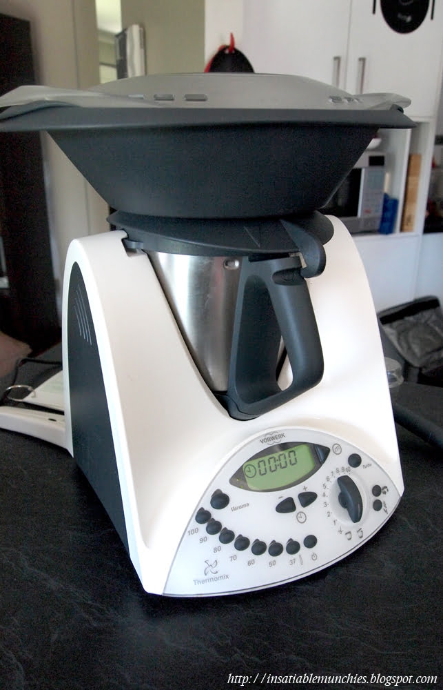 A Thermomix machine fitted with the steaming attachment