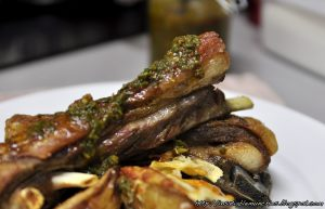 Lamb ribs are first boiled in a stock, then roasted to a crisp perfection, before being served with a tangy basil chimmichurri.