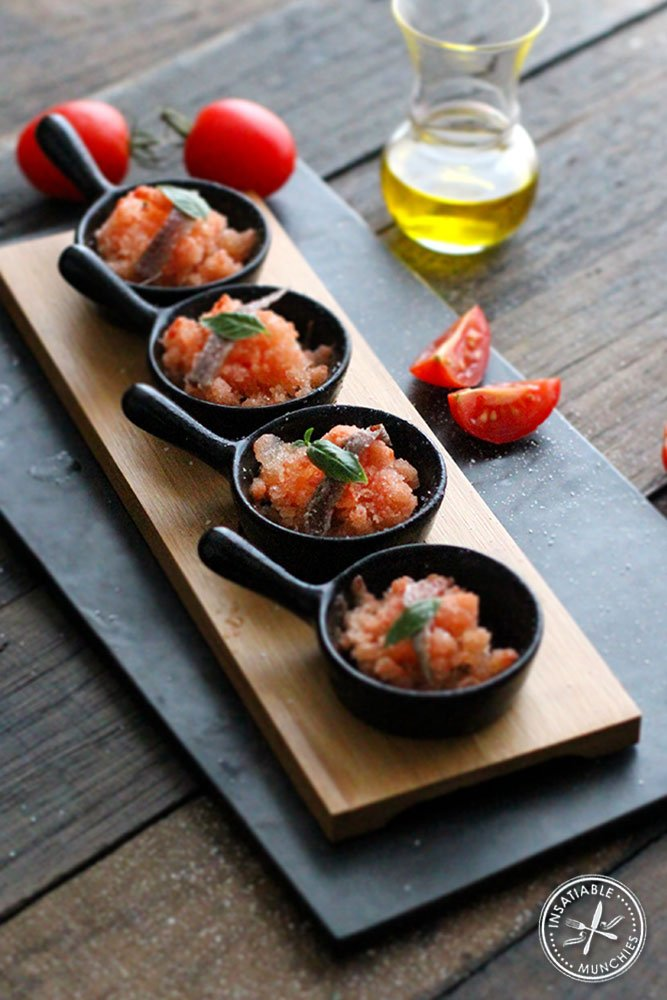 This is a granita version of the bloody mary, served in canapés with a sliver of anchovy and a baby leaf of basil