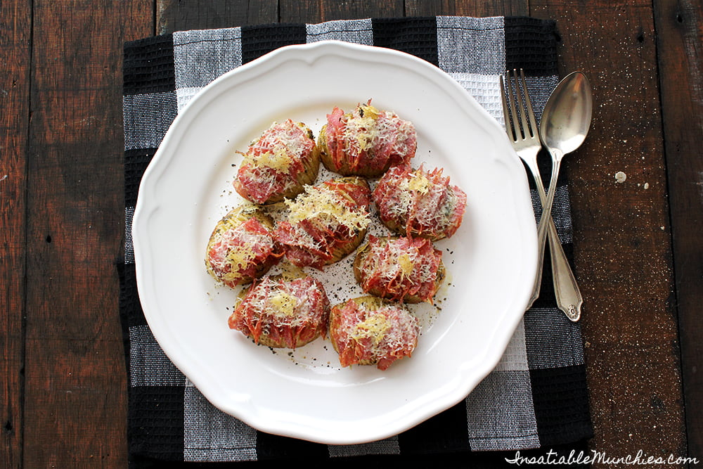Hasselback potatoes, stuffed with salami and covered in pecorino.