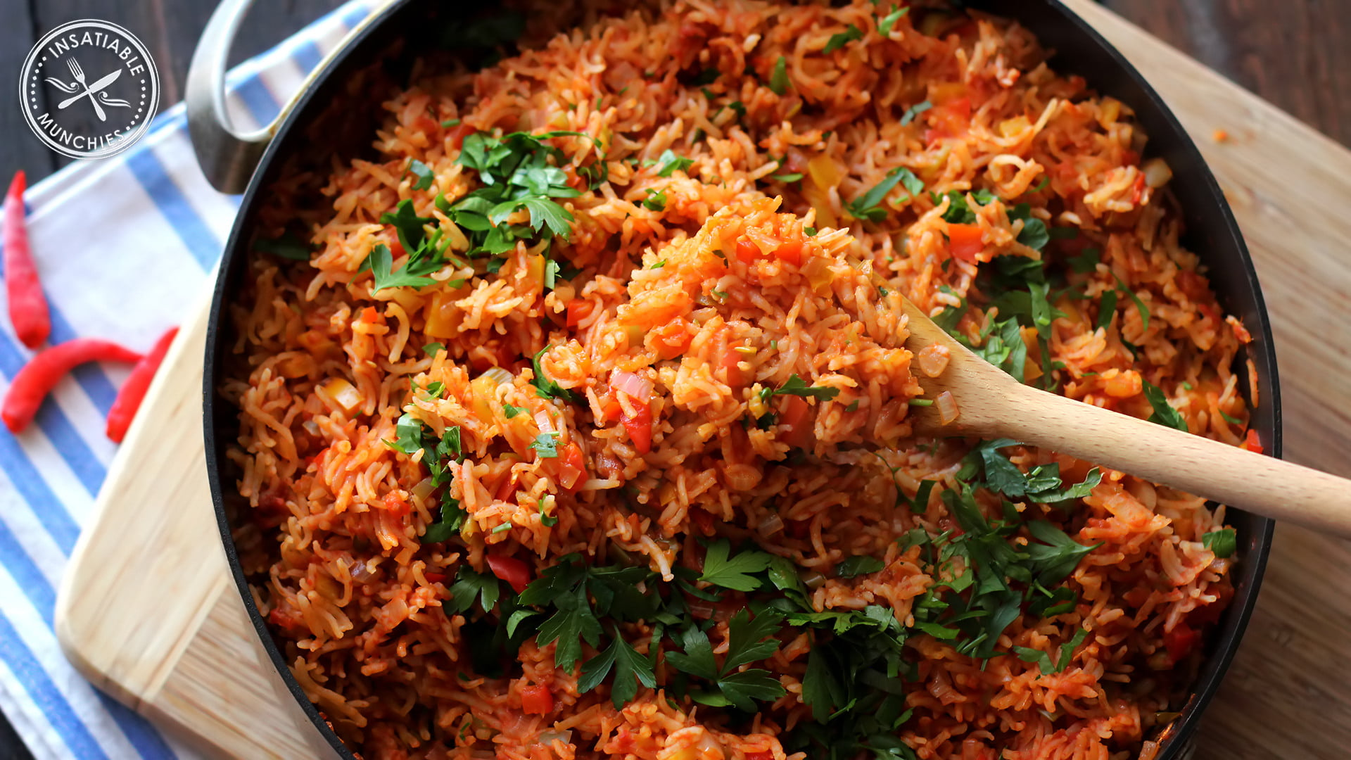 Rice, flavoured with capsicum, chilli and tomato, is cooked in a deep pan till it's fragrant and tender.