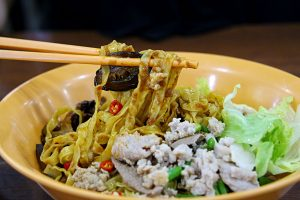 Thin egg noodles are tossed in with a house made chilli sauce, cooked pork mince, braised mushrooms, and generous lashings of vinegar