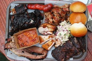A selection of barbecued offerings from the Oxford Tavern including brisket, beef short ribs, pork ribs, coleslaw, lamb ribs, smoky chorizo and sweet buttery bread rolls.