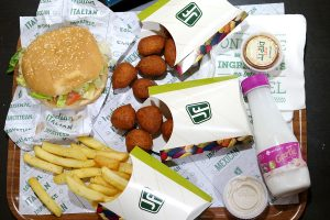 Clockwise from top left: American Sandwich, spinach and feta poppers, salsa dip, garlic yoghurt drink, fries and jalapeño cheese poppers in the centre.