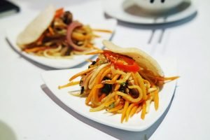 Pieces of cooked duck is mixed in with pickled turnip and carrot, and served with a prawn cracker in this entree from Bay Tinh