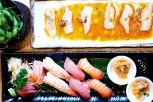 Clockwise from top left: pesto edamame, kingfish carpaccio, sushi and sashimi combination