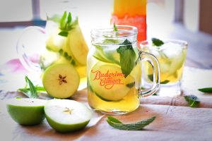 Refreshing Apple Green Tea and Ginger iced tea, garnished with mint