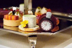 Top hat cake and timepiece macaron for high tea