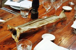 Whole Bakalar - Norwegian dried cod - sitting in the middle of the table