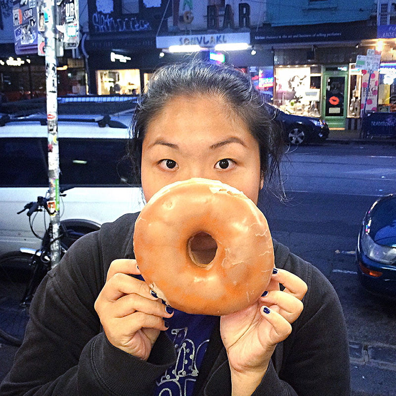 Me holding a giant donut the size of my face