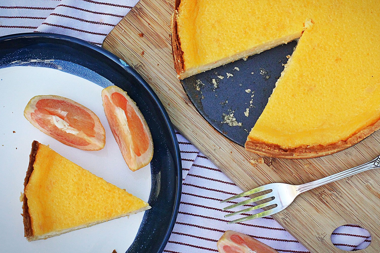 Aerial shot of grapefruit tart with a slice cut out on a plate