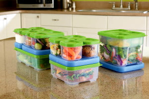 A stack of filled food containers, neatly nesting within each other